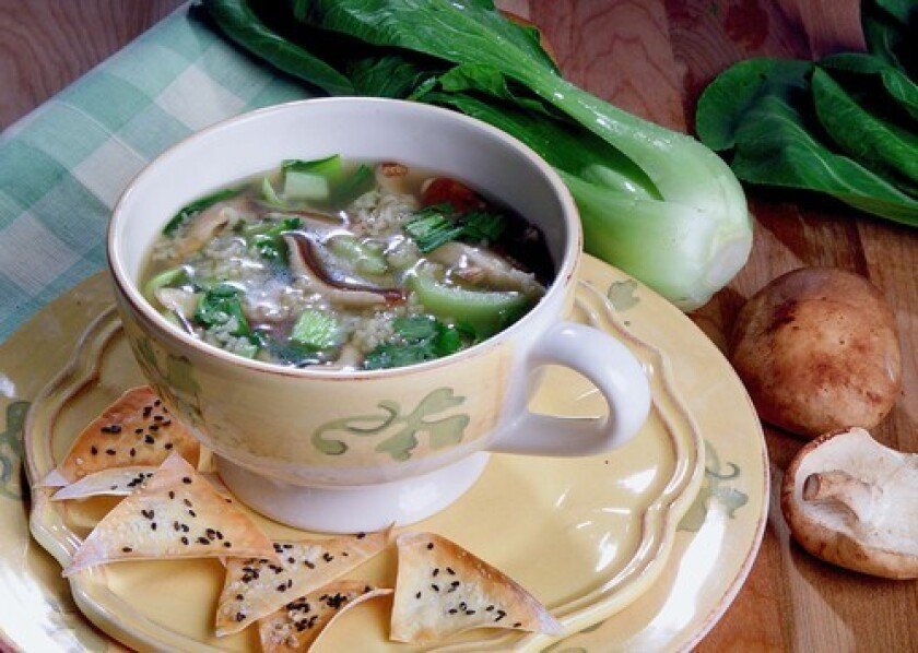 BETTER THE DAY AFTER: Ginger chicken soup with baby bok choy rests overnight to pick up flavor.