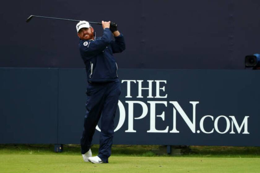 J.B. Holmes hits from the first tee during the final round of the British Open on Sunday.