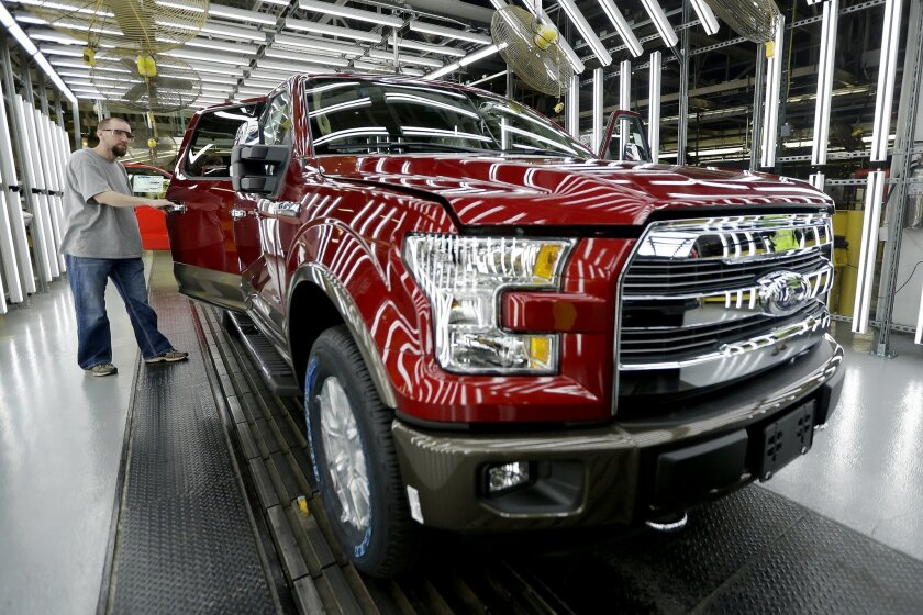 FILE - In this March 13, 2015 file photo, a worker inspects a new 2015 aluminum-alloy body Ford F-150 truck at the company's Kansas City Assembly Plant in Claycomo, Mo. The Commerce Department releases its August report on durable goods on Thursday, Sept. 24, 2015. (AP Photo/Charlie Riedel, File)