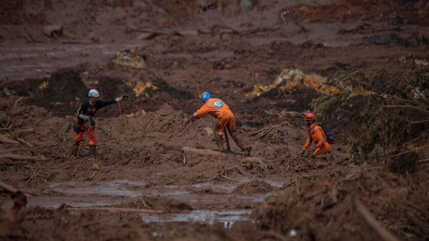Rescuers in Brazil search for victims in the mud-hit community of Casa Grande on Jan. 27, 2019. A dam at an iron ore mine belonging to the mining company Vale collapsed two days earlier near the southeastern town of Brumadinho.