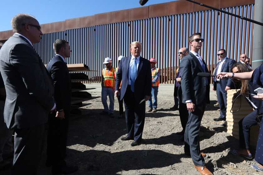 President Trump tours the U.S.-Mexico border fence in San Diego.