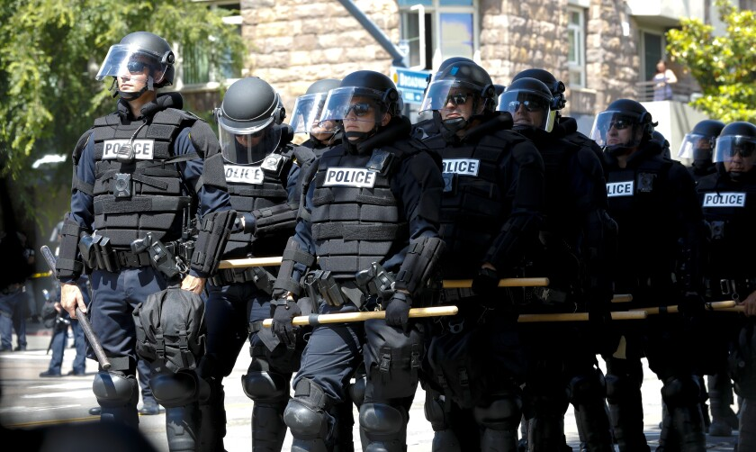 San Diego police in riot gear ready to prevent protesters from advancing to department headquarters in June 2020.