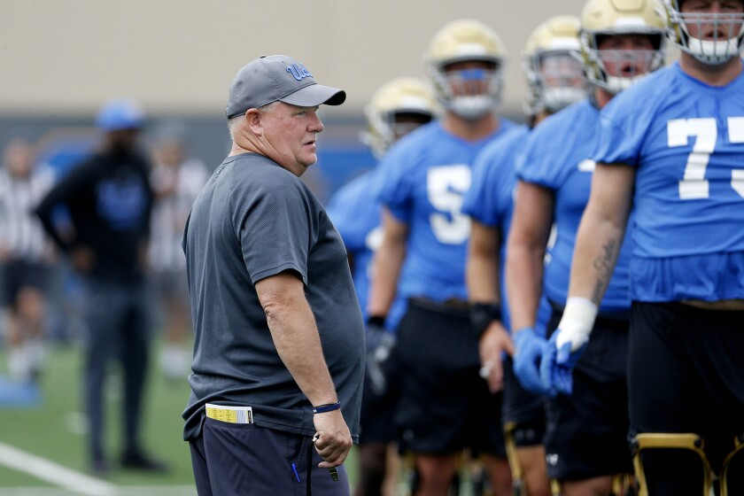 UCLA coach Chip Kelly talks to players during practice at the Wasserman Football Center on July 31, 2019.