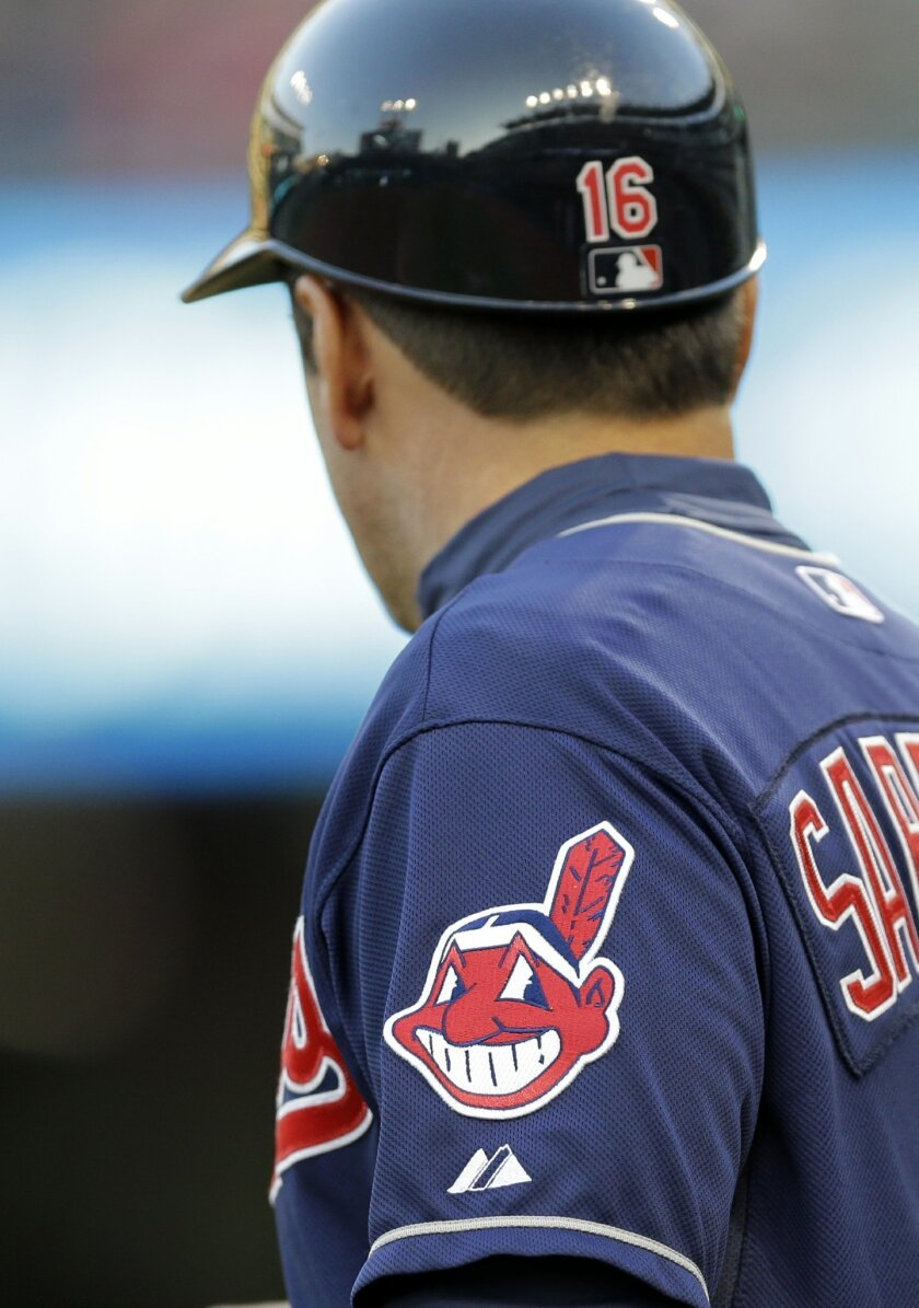 In this April 8, 2014 photo, the Cleveland Indians Chief Wahoo logo is shown on the uniform sleeve of third base coach Mike Sarbaugh during a baseball game against the San Diego Padres in Cleveland. Ohio state senator Eric Kearney says it's time for the Indians to drop their offensive name and Chief Wahoo mascot. Kearney, a Democrat from Cincinnati, introduced a resolution that if passed by the Legislature would encourage the baseball team to adopt a new name and mascot. (AP Photo/Mark Duncan)