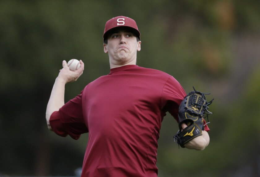 In this Thursday, Jan. 21, 2016, photo, Stanford pitcher Cal Quantrill warms up during a team workout in Stanford, Calif. (AP Photo/Marcio Jose Sanchez)