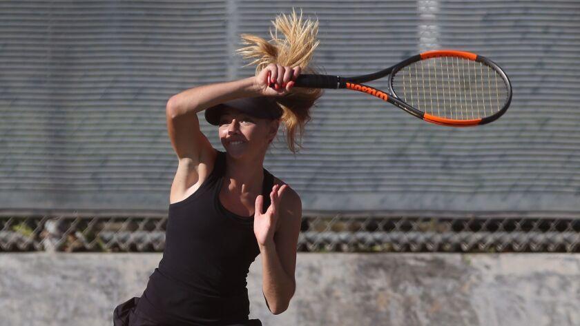 Huntington Beach doubles team Daniella Pokorny rips a forehand winner during Wave League tennis agai