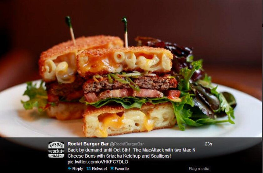The 'Mac Attack' burger from Rockit Burger Bar in Chicago is a burger between two fried mac and cheese buns.