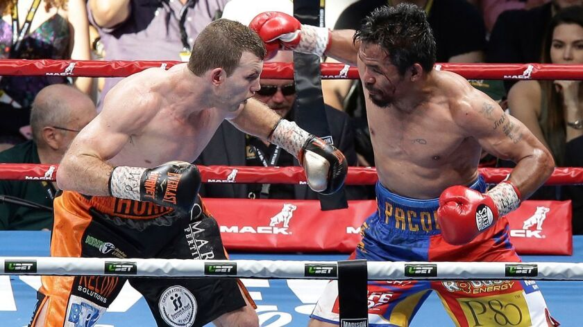 Manny Pacquiao, right, absorbed hard punches from Australian underdog Jeff Horn during their bout in Brisbane.