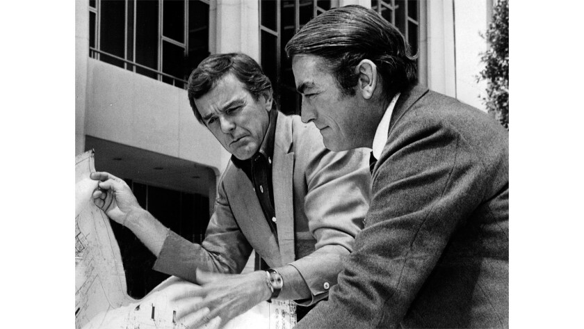 Actor Gregory Peck, right, and director-choreographer Gower Champion look over a floor plan of the Dorothy Chandler Pavilion of the Music Center.