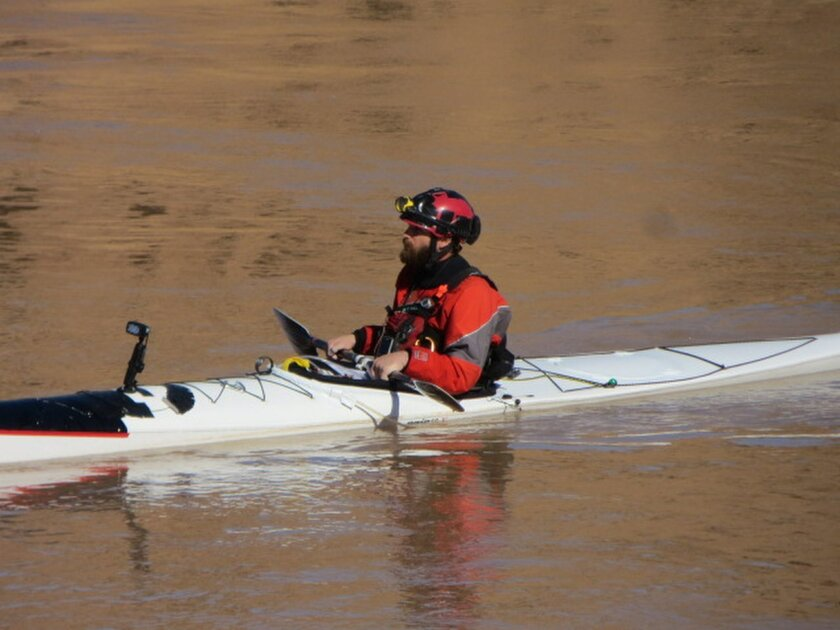 In this Sunday, Jan. 24, 2016 photo provided by Pamela Wolfson, Ben Orkin completes a record-breaking trip on the 277-mile stretch of the Colorado River through the Grand Canyon. Orkin paddled his kayak for 34 hours and two minutes. (Courtesy of Pamela Wolfson via AP)