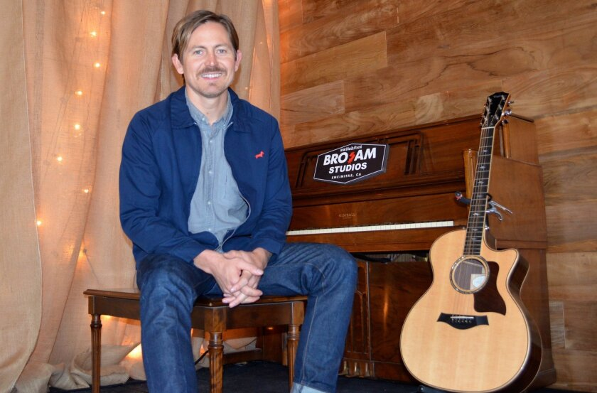 Switchfoot's Chad Butler at the new Bro-Am Studios, where kids can go for lessons and to jam. Butler said the Encinitas studio is a natural extension of the Switchfoot Bro-Am surf contest and concert, happening July 11 at Moonlight Beach
