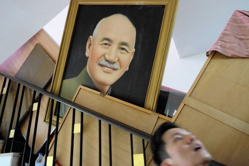 A portrait of former Taiwanese President Chiang Kai-shek is seen during a protest at the parliament building in Taipei in March.
