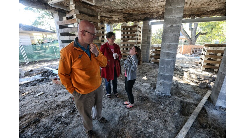 HOUSTON, TEXAS, SATURDAY, OCTOBER 28, 2017 - Drew Shefman, his wife Pam and daughter Quinn stand bel