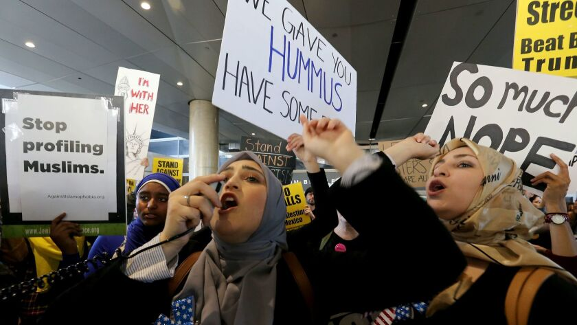 Women protest President Trump's travel ban at LAX last month.