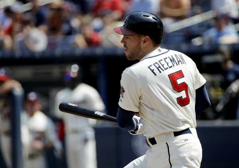 Atlanta Braves' Freddie Freeman singles to score teammate Michael Bourn in the first inning of a baseball game against the Philadelphia Phillies Sunday, Sept. 20, 2015, in Atlanta. (AP Photo/David Goldman)
