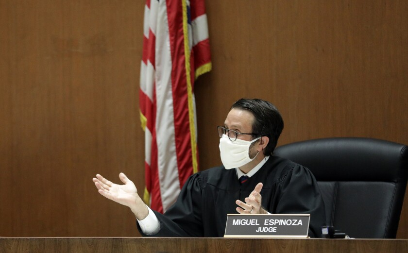 Los Angeles Superior Court Judge Miguel Espinoza holds arraignments in his courtroom via video at Clara Shortridge Foltz Criminal Justice Center on April 21 in Los Angeles.