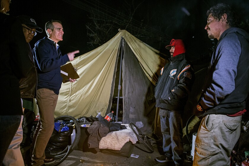 Mayor Eric Garcetti, joined by L.A. County Supervisor Mark Ridley-Thomas, talks with Manny Munoz and Ricardo Seleuco as they count homeless people on Jan. 22, 2019.