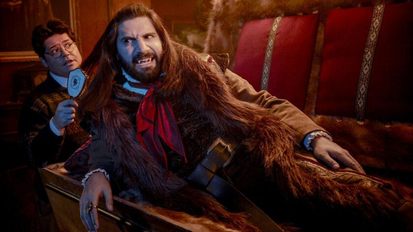 "This image released by FX shows Kayvan Novak and Harvey Guillen, left, in a scene from ""What We Do I"