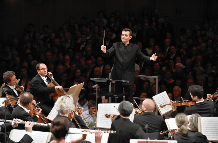 Lionel Bringuier, seen conducting the Tonhalle Orchestra Zurich in 2014, will be on a familiar stage with familiar faces when he leads the L.A. Philharmonic and pianist Yuja Wang at the Hollywood Bowl on Tuesday.