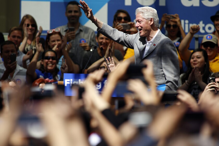 Former President Bill Clinton campaigns for his wife at the Los Angeles Trade-Technical College in Los Angeles on April 3.