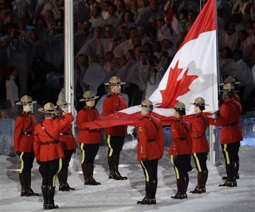 The Canadian flag is raised during the closing ceremony for the Vancouver 2010 Olympics in Vancouver, British Columbia, Sunday, Feb. 28, 2010. (AP Photo/Gerry Broome)