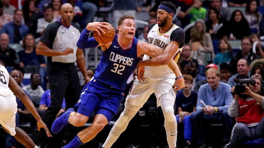 LA Clippers forward Blake Griffin (32) tries to get past New Orleans Pelicans forward Anthony Davis