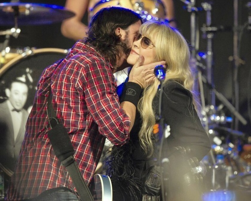 Dave Grohl greets Stevie Nicks before they perform during SXSW 2013.