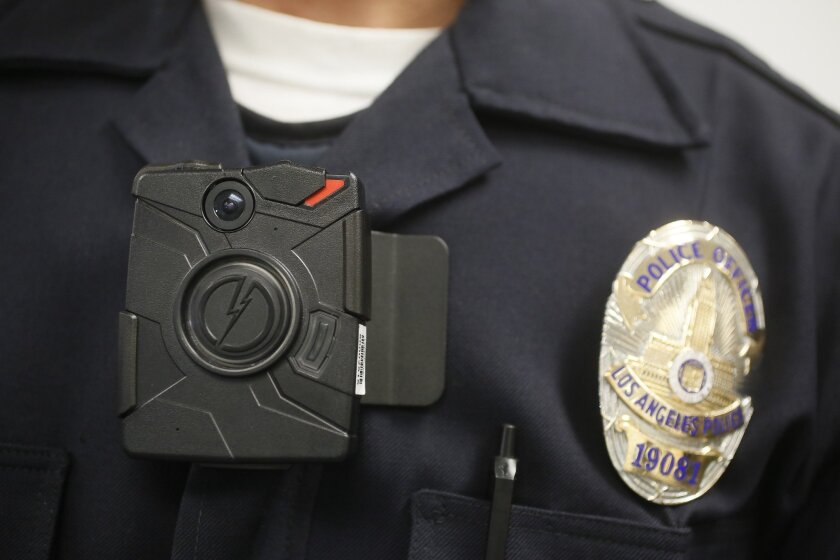 A Los Angeles Police officer wears an on-body camera during a demonstration for media in Los Angeles.