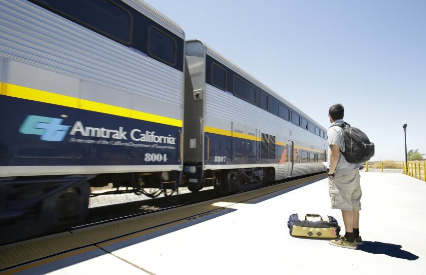In this photo taken Wednesday, July 17, 2013, a passenger waits to board an Amtrak California train in Madera, Calif. Sacramento County Superior Court Judge Michael Kenny ruled Monday, Nov. 25, 2013, to reject a request from the California High-Speed Rail Authority to sell $8 billion of the $10 bil