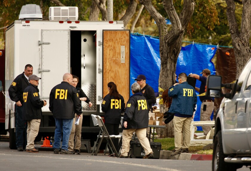 FBI agents search the Long Beach home of Stephen Beal, who was arrested in connection with a fatal blast at an Aliso Viejo day spa that claimed the life of his ex-girlfriend and business partner last year.