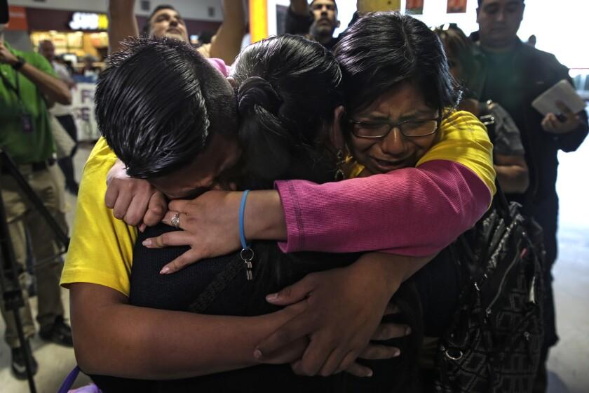 Maria de Lourdes Molina Garcia reunites with her children, Iris, right, and Luis Hipolito at the airport in Ciudad Juarez, Mexico.