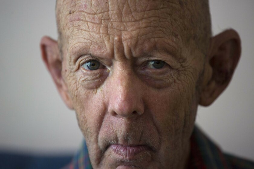 In this Feb. 4, 2016 photo, Otto Macias sits at his home during an interview in Havana, Cuba. Macias fled the Cuban revolution for the U.S. at 19, then spent eight years in Vietnam as a heavy machine-gunner fighting for his new country. The department of Veterans´Affairs cut off his benefits after