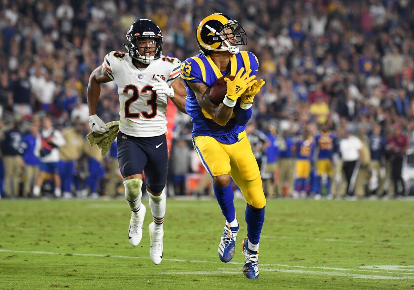 Rams receiver Josh Reynolds catches a long pass in front of Chicago Bears cornerback Kyle Fuller.