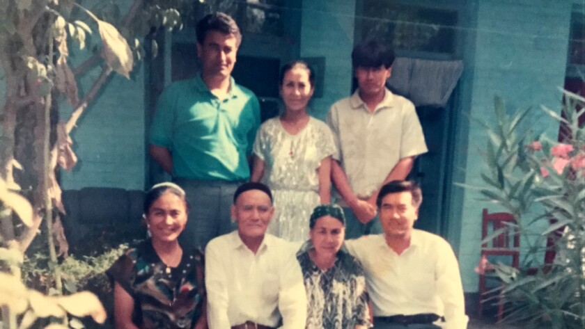 Nury and Tashpolat Tiyip with their two sisters, older brother and parents at home in Xinjiang in 1992.