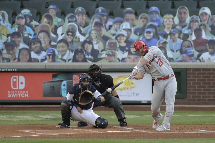 Angels slugger Mike Trout hits a solo home run during the first inning of a game against Seattle on Aug. 4 .