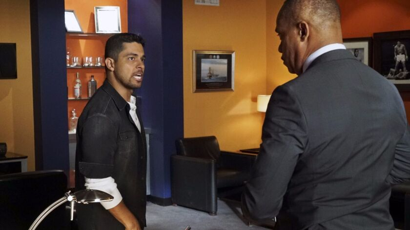 "Wilmer Valderrama, left, and Rocky Carroll in ""NCIS"" on CBS. (Bill Inoshita/CBS)"