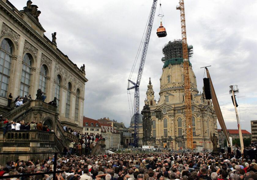 By using a special crane, workers raise