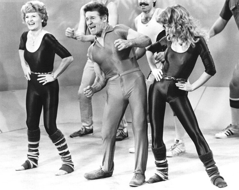 Jack LaLanne is joined by his wife, Elaine, left, and co-host Lezlie Allyn in leading an exercise session in 1982.