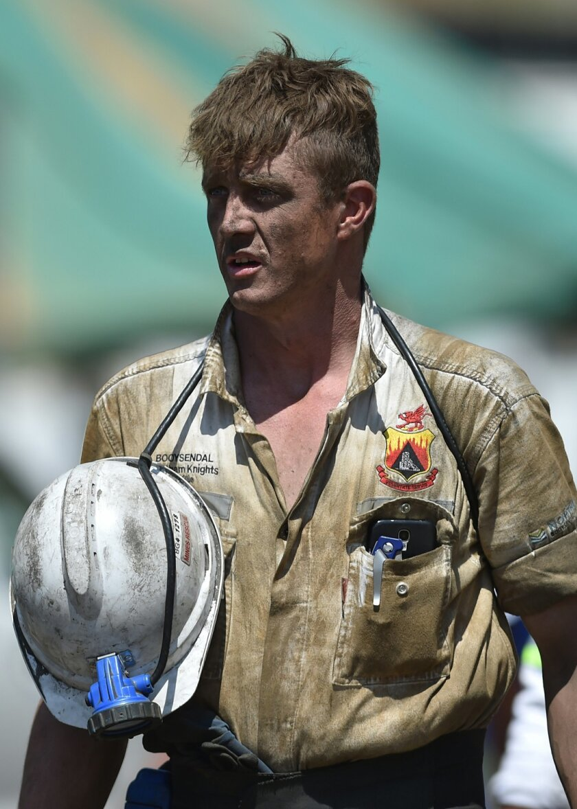 A search and rescue team member at the Lily Gold Mine near Barberton, South Africa, Saturday Feb. 13, 2016. Rescue operations were forced to suspend a search for three people trapped in a container underground for more than a week after a second collapse Saturday. The search would resume once condi