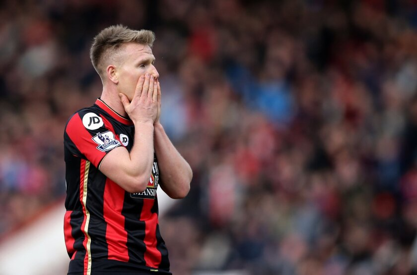 AFC Bournemouth's Matt Ritchie reacts after a missed chance to score, during  the English Premier League soccer match between Bournemouth and Arsenal,  at the Vitality Stadium, in Bournemouth, England, Sunday Feb. 7, 2016. (John Walton/PA via AP) UNITED KINGDOM OUT