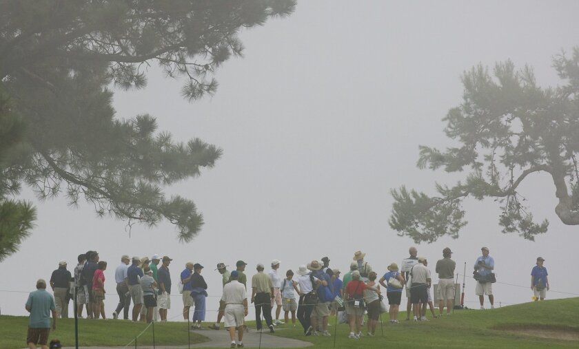 Spectators at Torrey Pines for the second round of the LPGA's Samsung World Championship got a liberal dose of San Diego's late-morning fog yesterday. With temperatures in the 90s, roofers Rob Tomeoni (foreground below) and Mike Hernandez sweltered atop a home in Poway. (Nelvin C. Cepeda / Union-Tr