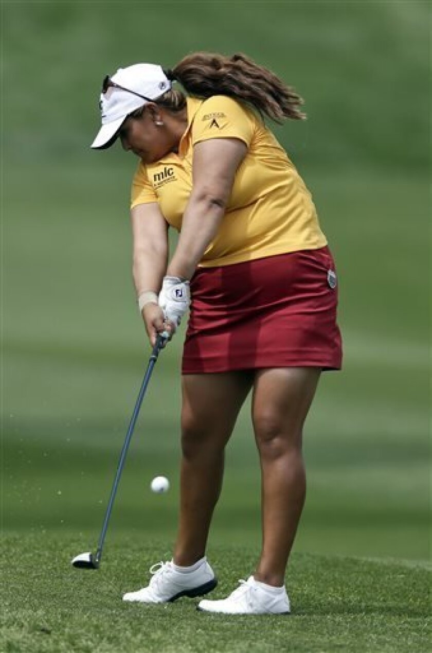 Lizette Salas hits from the rough on the second hole during the final round of the LPGA Kraft Nabisco Championship golf tournament in Rancho Mirage, Calif., Sunday, April 7, 2013. (AP Photo/Chris Carlson)