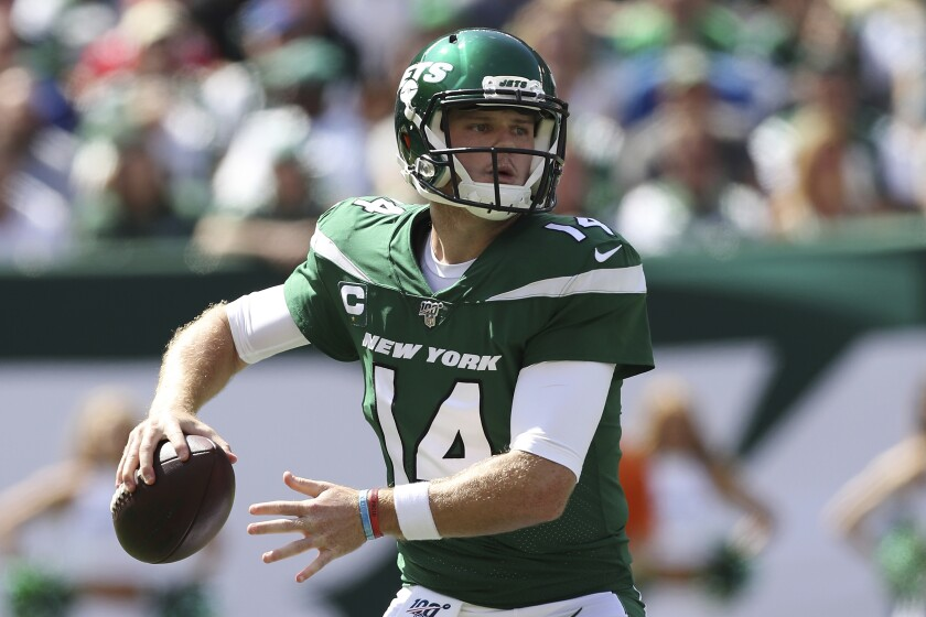 FILE - In this Sept. 8, 2019, file photo, New York Jets quarterback Sam Darnold (14) makes a pass during an NFL football game against the Buffalo Bills, in East Rutherford, N.J. Darnold has been cleared by doctors for non-contact activities, but his availability for New York's game at Philadelphia remains uncertain. Coach Adam Gase says Monday, Sept. 30, 2019, that Darnold can begin throwing footballs at practice this week but can't yet lift weights as he continues to recover from a bout with mononucleosis that has sidelined him the last two games. (AP Photo/Steve Luciano, File)