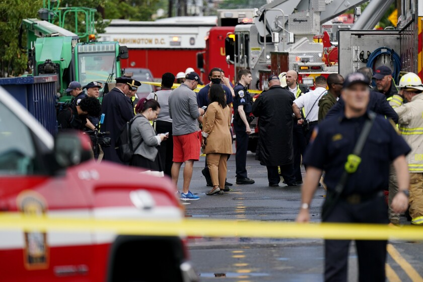 Emergency crews respond after a building under construction collapsed Thursday, July 1, 2021, in Washington. (AP Photo/Carolyn Kaster)