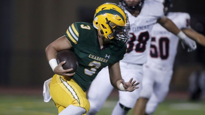 Edison High running back Kobe Lopez carries the ball against San Clemente during the first half in a