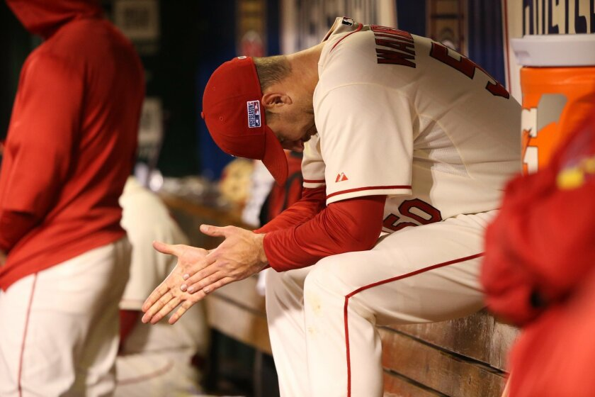 Adam Wainwright sits in the dugout after getting pulled in the fifth inning during Game 1 of the National League Championship Series between the St. Louis Cardinals and the San Francisco Giants on Saturday, Oct. 11, 2014, at Busch Stadium in St. Louis. Cardinals' lost to the San Francisco Giants 3-0 in the NL Championship Series opener. (AP Photo/St. Louis Post-Dispatch, Chris Lee)