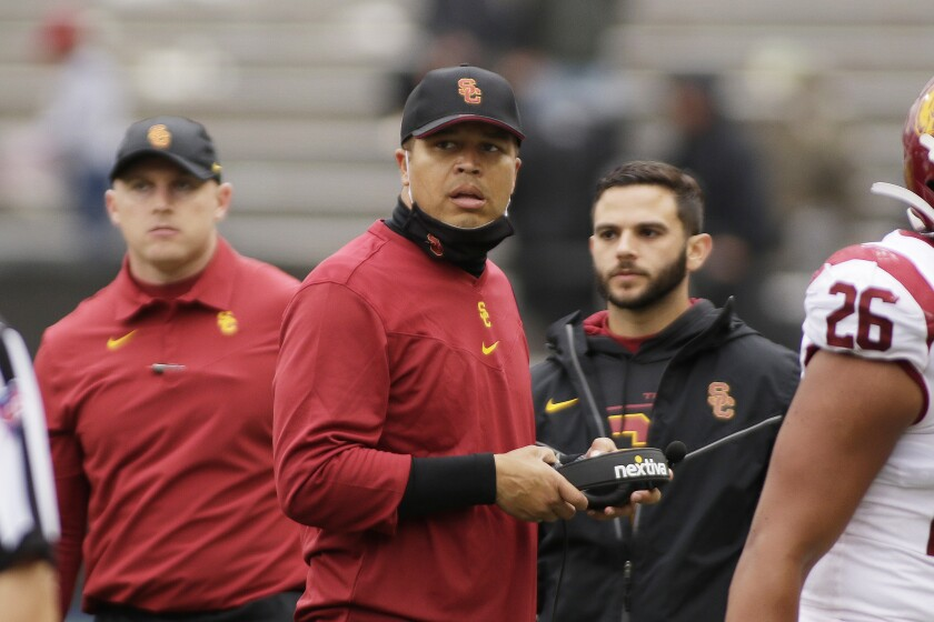 USC interim head coach Donte Williams looks on from the sideline.