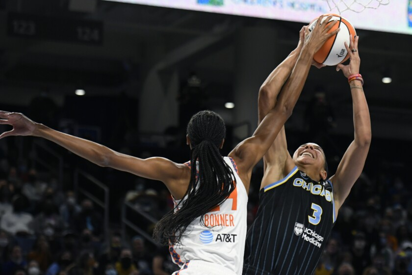Chicago Sky's Candice Parker (3) shoots while being fouled by Connecticut Sun's DeWanna Bonner (24) during the first half of Game 4 of a WNBA basketball playoff semifinal, Wednesday, Oct. 6, 2021, in Chicago. (AP Photo/Paul Beaty)