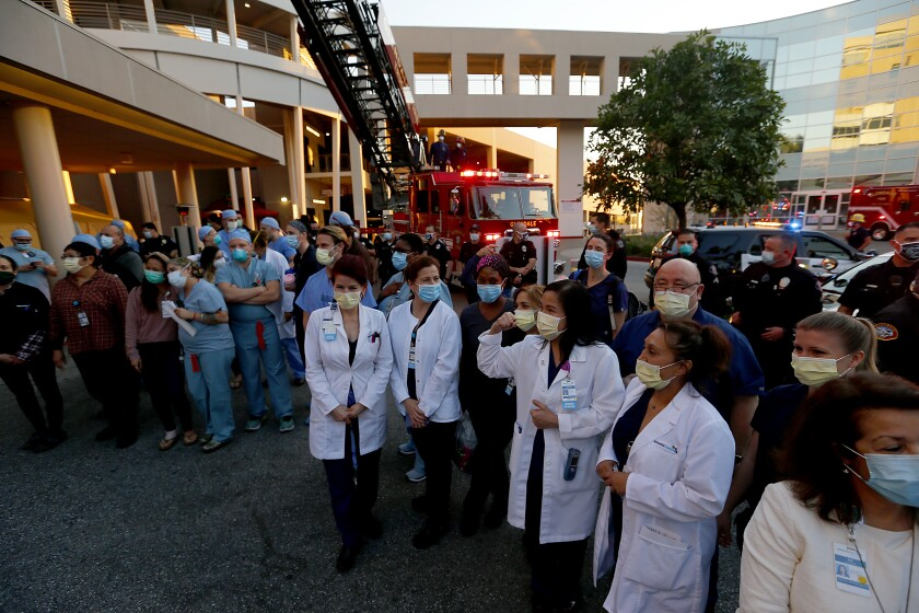 Healthcare workers, police and firefighters gather for a tribute to the fight against the coronavirus at Glendale Adventist Hospital.