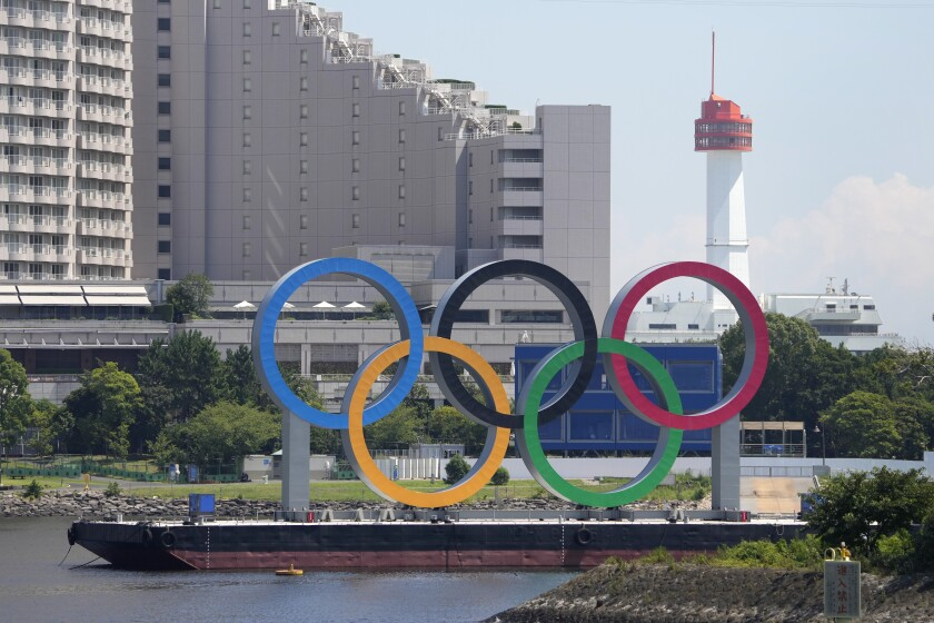The Olympic rings float on a barge in Tokyo